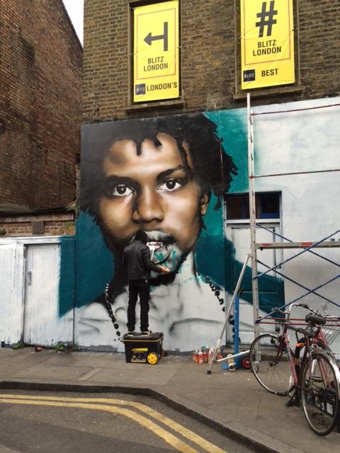 Street artist in action just off Brick Lane