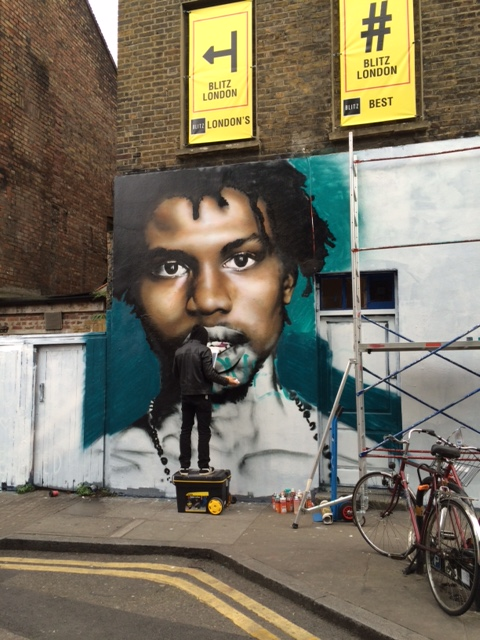 Street artist in action just off Brick Lane
